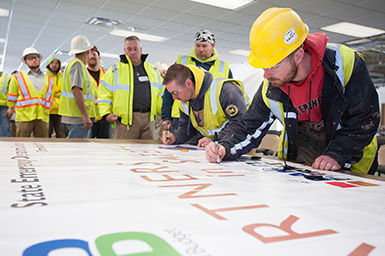 Christman, Daniels Building Co., Inc. and MIOSHA Sign Partnership to Protect Workers During State Emergency Operations Center Project